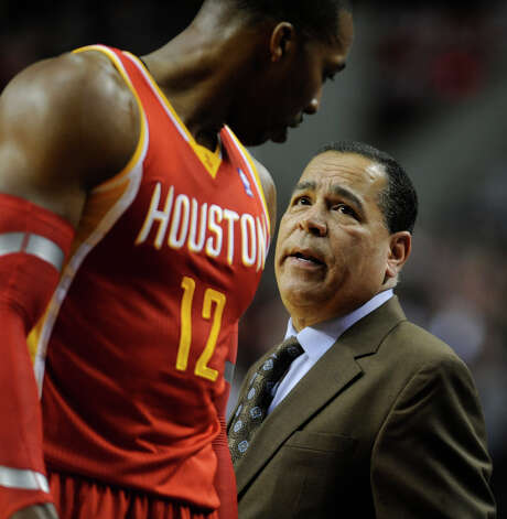 Houston Rockets  assistant coach Kelvin Sampson talks with Dwight Howard against Portland Trail Blazers' during the first half of an NBA basketball game in Portland, Ore.,Thursday Dec. 12, 2013. (AP Photo/Greg Wahl-Stephens) Photo: GREG WAHL-STEPHENS, FRE / FR29287 AP