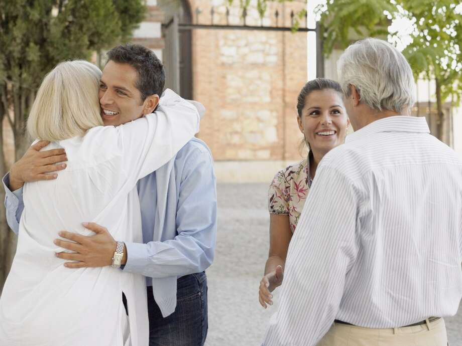 Meeting your family: Prepare your partner for your own family's idiosyncrasies whenever possible. Warn them that grandpa is a little deaf and stuck in WWII, make sure they know the cousins from out of town are religious and have special rituals they honor, let them know the stuffing is supposed to taste like that. The less surprises the better. Photo: Image Source, Getty Images