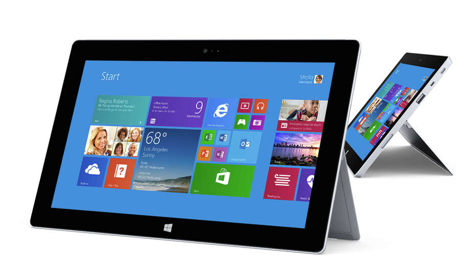 Microsoft sells a 10.6-inch RT tablet, the Surface 2, for $449. For $130 more,  you can get a keyboard cover with keys that move. A more powerful version, the Surface Pro 2, starts at $899. It runs a regular version of Windows 8.1, meaning it can run older Windows programs, not just ones designed for RT. Microsoft markets these as laptop replacements, and the cover has been redesigned such that it works better for typing on your lap. Photo: Microsoft