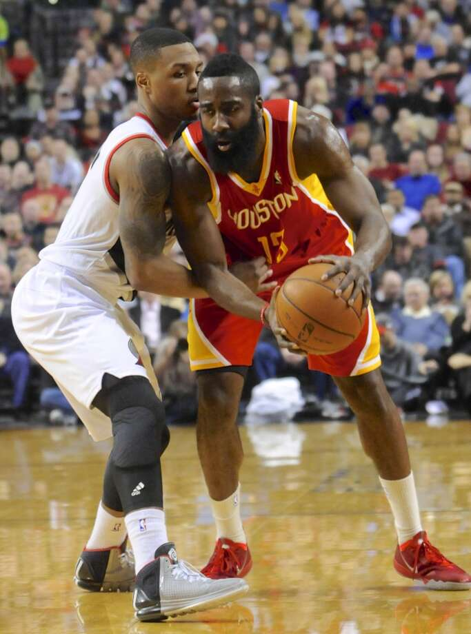 James Harden (13) looks to pass  against Damian Lillard (0). Photo: GREG WAHL-STEPHENS, Associated Press