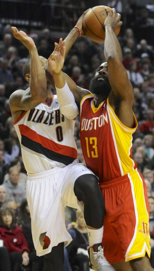 James Harden (13) shoots against Damian Lillard (0). Photo: GREG WAHL-STEPHENS, Associated Press