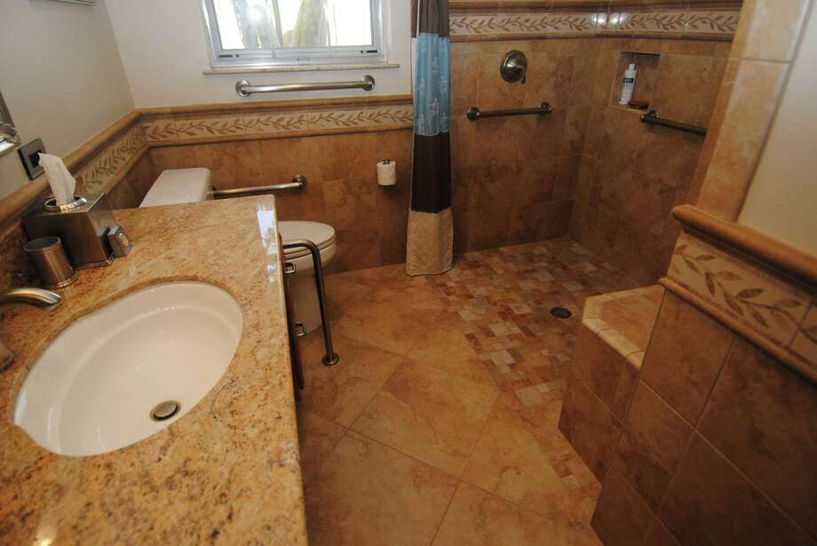 This bathroom was designed with Universal Design for wheelchair access by Legal Eagle Contractors Inc.