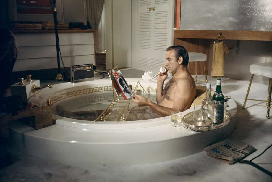 James Bond star Sean Connery takes a relaxing bath with a vodka martini on the set of the film 'Diamonds Are Forever', 1971. (Photo by Terry O'Neill/Getty Images) Photo: Terry O'Neill, Getty Images