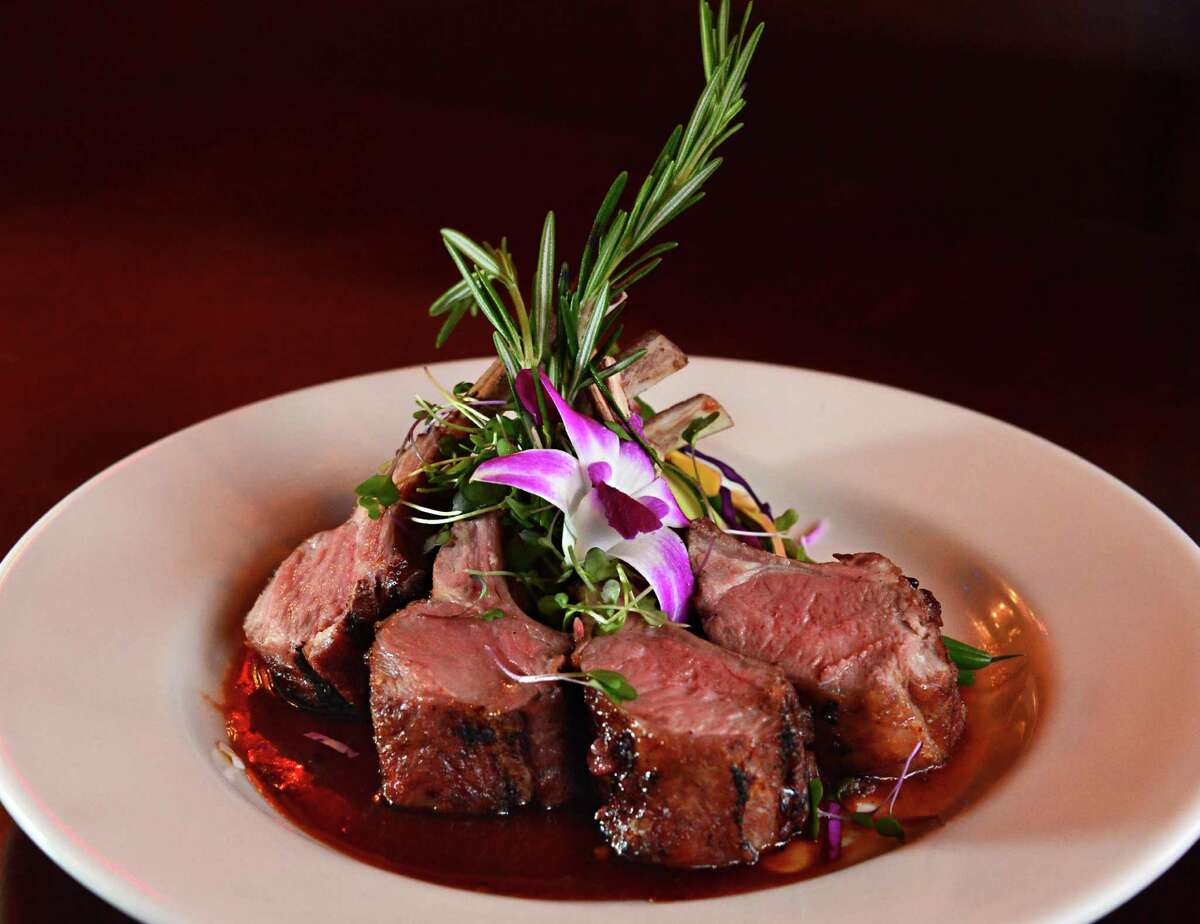 Rack of lamb is a popular restaurant special for Easter dinner. (John Carl D'Annibale/Times Union)
