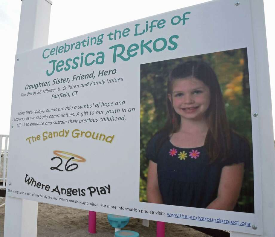 Jessica Rekos' smiling face greets visitors to the Penfield Beach playground built as a memorial to her. Photo: Gevevieve Reilly, Fairfield Citizen / Geneviueve R / Fairfield Citizen