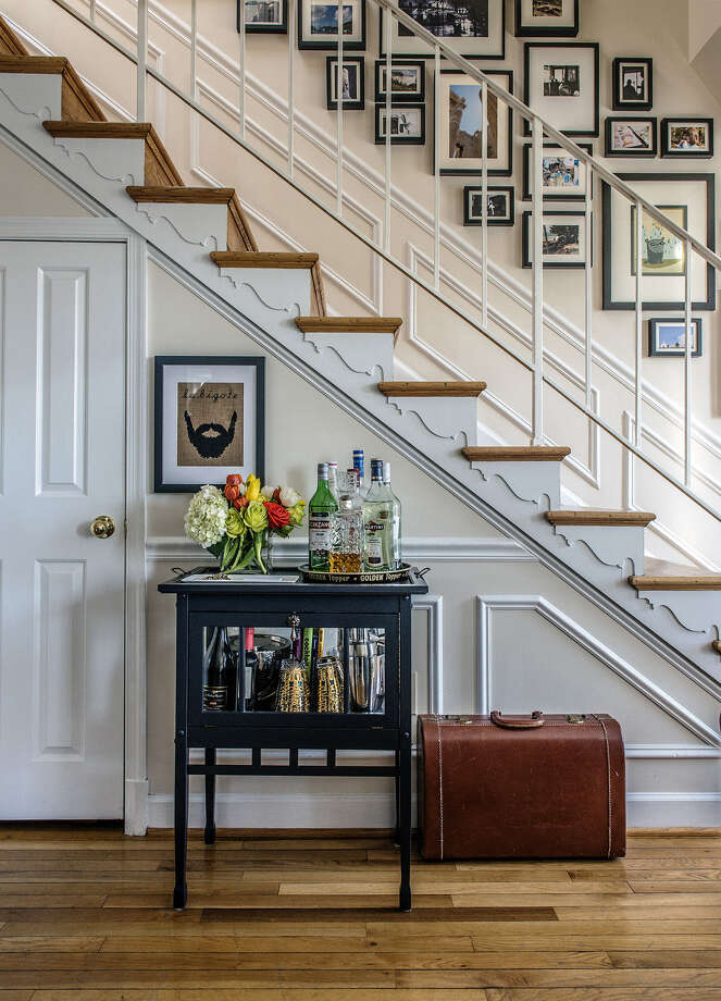 Kerra Michele Huerta lined a stairway with several dozen framed photos in her one-bedroom apartment. Photo: Bill O'Leary / Washington Post / The Washington Post