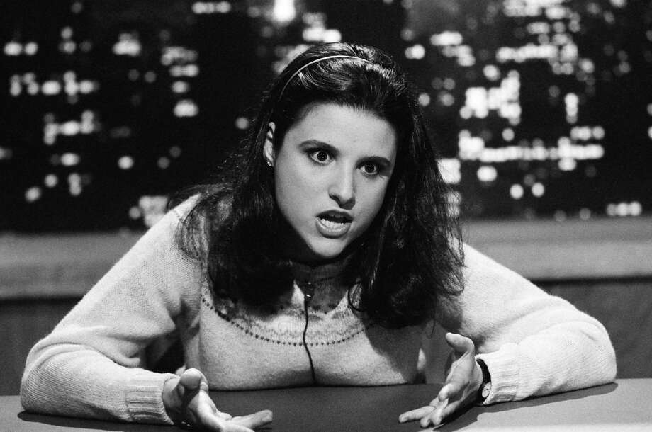 "Julia Louis-Dreyfus, who played Margo Chester, was a cast member of ""Saturday Night Live"" before playing the sneering snob next door on ""Christmas Vacation."" Photo: NBC, Getty / © NBCUniversal, Inc."