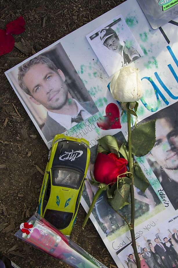 Fans remember Paul Walker at the site of his fatal car crash in Valencia. Photo: Ringo H.W. Chiu, Associated Press