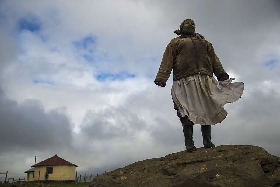 Village's most famous son is coming home: An Xhosa woman stands on a rock overlooking Qunu, South Africa, as preparations continue ahead of the funeral of former South African President Nelson Mandela. Mandela will be buried in Qunu, his hometown. Photo: Dan Kitwood, Getty Images