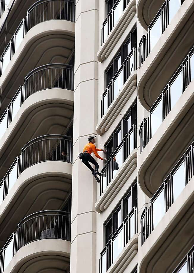 "Who needs stairs? Not Alain Robert, a.k.a. ""The French Spiderman,"" who is climbing the Metropolis Building in Aukland during lunch hour. Photo: Jason Oxenham, Getty Images"