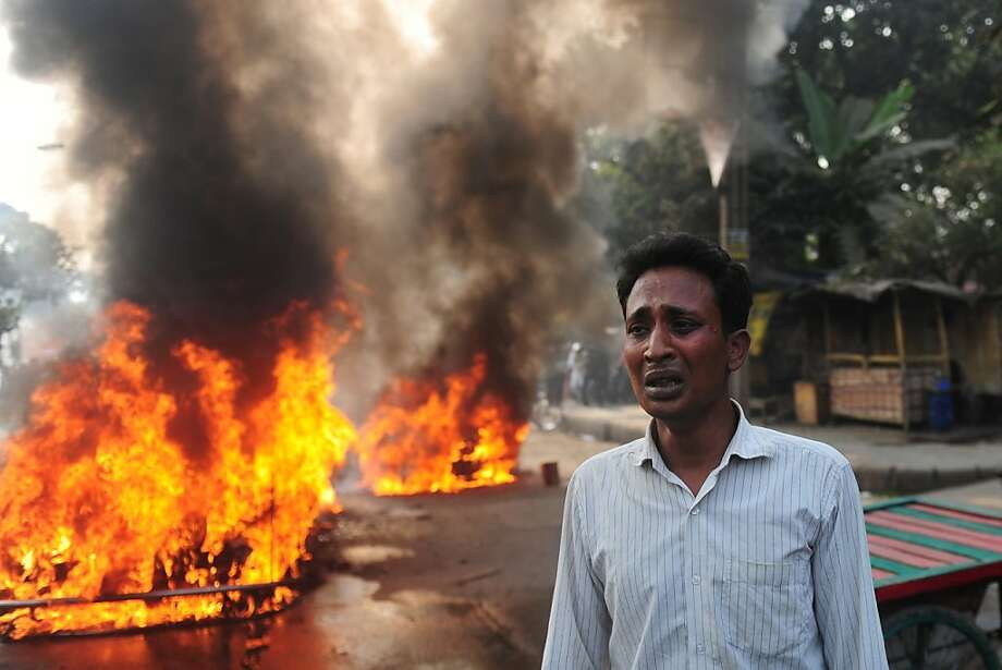 Look what they did to my car: A Bangladeshi man cries after Jamaat-e-Islami rioters set his car on fire in Dhaka. Islamists went on a rampage in the city after Abdul Quader Molla, a top Islamist leader convicted of war crimes, was executed, and this man's automobile was an innocent victim. Photo: Munir Uz Zaman, AFP/Getty Images