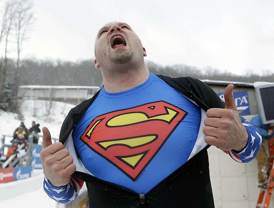 No wonder he won:Mild-mannered bobsledder Steven Holcomb reveals his secret identity after he and brakeman Steven Langton slid to victory in the two-man bobsled World Cup event in Lake Placid, N.Y. Photo: Mike Groll, Associated Press