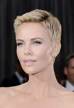 Going short: Who made the cut in 2013 — and why? Sure, Michelle Williams, Miley Cyrus and even the much-hated-on Anne Hathaway knew how to rock a pixie in years past. But what made so many choose to get on the short list this year? All the Jennifers seemed to be doing it: Aniston, Hudson and, last but not least, Jennifer Lawrence.  Going to new extremes with très gamine pixies were Beyoncé, Coco Rocha, Charlize Theron (pictured), Shailene Woodley, Maggie Gyllenhaal, Paula Patton, Jaime Pressly, Selita Ebanks, Elettra Wiedemann, and Kristin Chenoweth, though it was tough to one-up the faux-hawking shaved sides of Jada Pinkett Smith. Photo: Michael Buckner, Getty Images