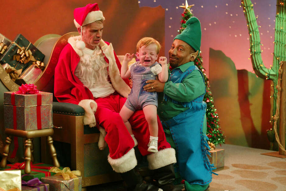 "The character played by Billy Bob Thornton (left) impersonates a department-store-Santa — in a rude, crude, substance-abusing-and-wholly-unsuited-to-the-job sort of way — in Miramax's ""Bad Santa."" It is, for some, the antidote to the overdose of cinematic treacle Hollywood serves up each Christmas season. Photo: Miramax / MIRAMAX"