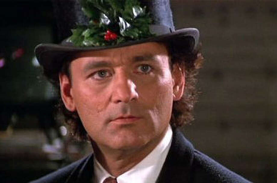 "'Scrooged' - Bill Murray is filled with holiday humbuggery in ""Scrooged,"" a modern take on ""A Christmas Carol."" Photo: Paramount Pictures 1988 / ONLINE_YES"
