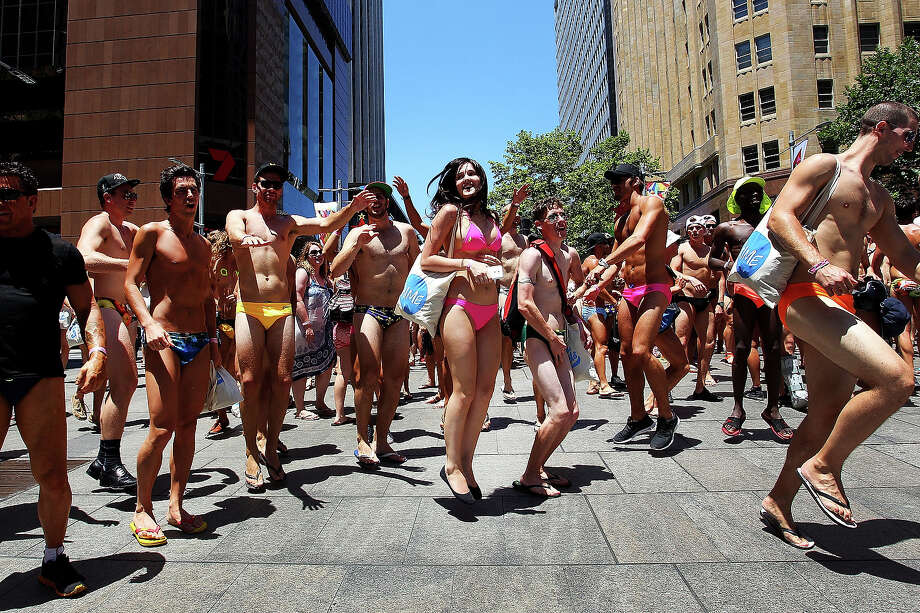 While Americans are freezing their butts off amid a rash of winter storms, Australians are flaunting their tanned bikini bods thanks to the the Earth's orbit. Jealous much?Above: Sydneysiders take part in the 'AIME Strut the Streets' parade in Martin Place on December 13, 2013 in Sydney. Photo: Lisa Maree Williams, Getty Images / 2013 Getty Images