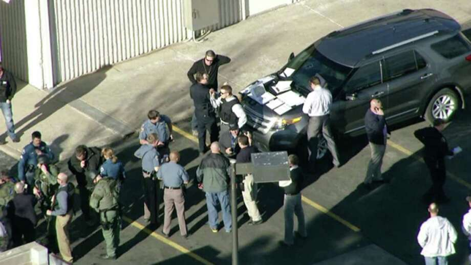 In this still image taken from video provided by Fox 31 Denver, police respond to reports of a shooting at Arapahoe High School in Centennial, Colo. Friday, Dec. 13, 2013. Colorado division of emergency management spokeswoman Micki Trost said her director went to the school and their weren't any more immediate details. (AP Photo/KDVR) MANDATORY CREDIT Photo: Uncredited, Fox 31 Denver / KDVR