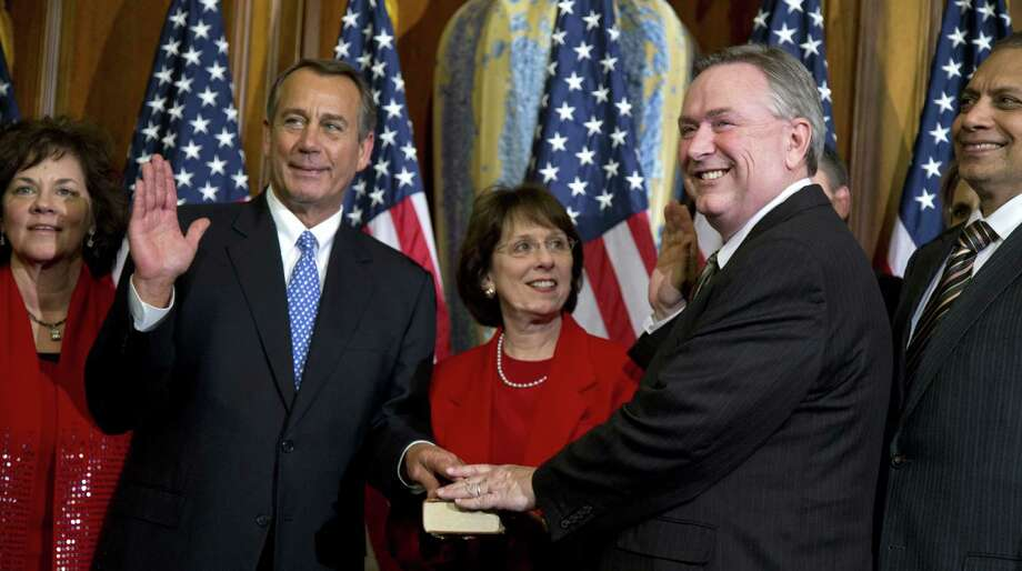 Rep. Steve Stockman, R-Texas (right), participates in a mock swearing-in  with House Speaker John Boehner.  Stockman filed a last-minute bid to run against U.S. Sen. John Cornyn. Photo: Evan Vucci / Associated Press / AP