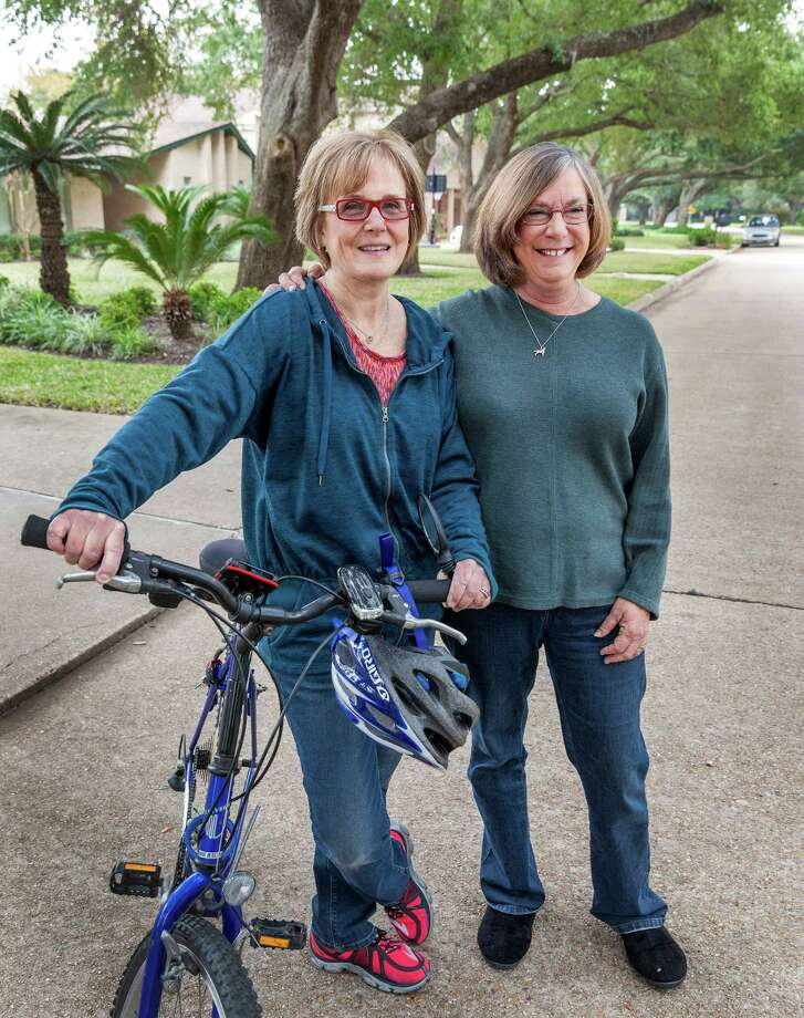 Debbie Rothschild, left, with her friend, Rae Scarcella near Rothschild's Sugar Land home. Rothschild experienced cardiac arrest while biking and was saved by Scarcella's CPR by the roadside. Photo: Craig Hartley, Freelance / Copyright: Craig H. Hartley