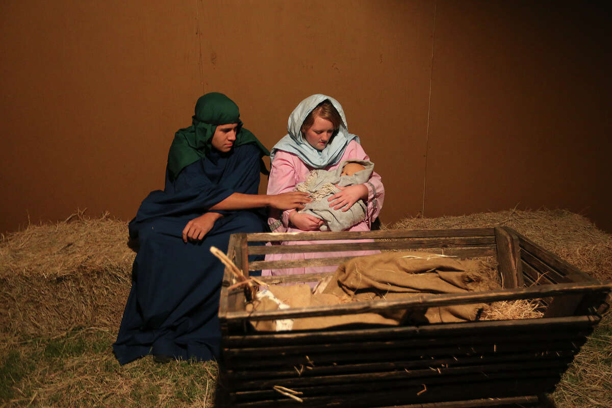 'Joseph,' played by Andrew Nolen, 16, and 'Mary,' played by Savannah Willis, 15, sit in a stable with the baby Jesus during a dress rehearsal of the Christmas story at the Gateway Church grounds in southwest San Antonio, Wednesday, Dec. 11, 2013.
