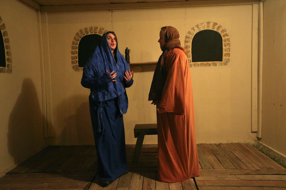 'Mary,' left, played by Brittany Willis and 'Elizabeth,' played by Laura Schlotfeldt, go through a dress rehearsal of the Christmas story at the Gateway Church grounds.