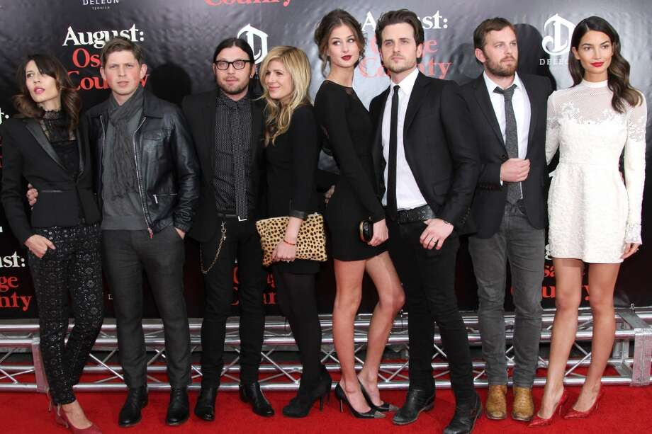 "(L-R) Johanna Bennett, Matthew Followill, Nathan Followill, Jessie Baylin, Martha Patterson, Jared Followill, Caleb Followill and Lily Aldridge attend the ""August: Osage County"" premiere at Ziegfeld Theater on December 12, 2013 in New York City. Photo: Rob Kim, Getty Images For DeLeon Tequila"