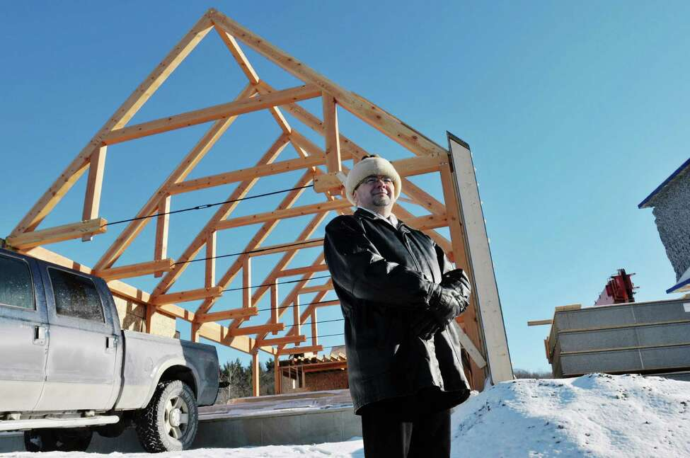 Anton Kapusi, the pastor of the Seventh-day Adventist Church of Kinderhook, poses at the construction site of the new church building on Thursday, Dec. 12, 2013, in Kinderhook, N.Y. (Paul Buckowski / Times Union)