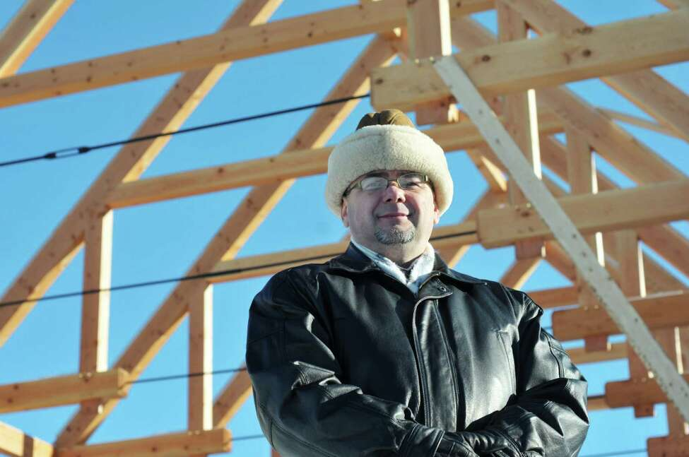 Anton Kapusi, the pastor of the Seventh-day Adventist Church of Kinderhook, poses at the construction site of the new church building Thursday, Dec. 12, 2013, in Kinderhook, N.Y. (Paul Buckowski / Times Union)
