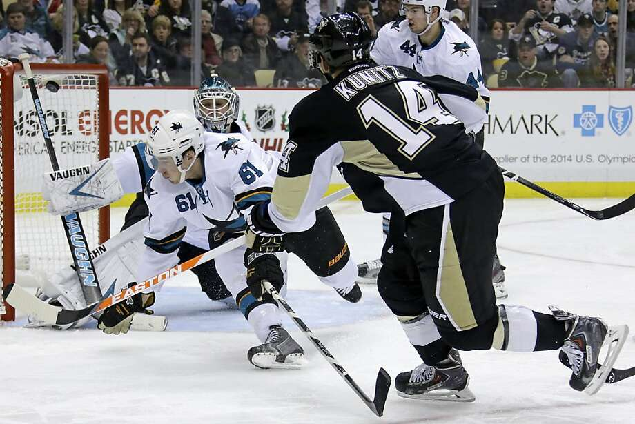 Chris Kunitz of Pittsburgh scores in a 5-1 win over San Jose on Dec. 5, part of the Sharks' recent struggles on the road.  San Jose has lost four of its past five road contests. Photo: Gene J. Puskar, Associated Press