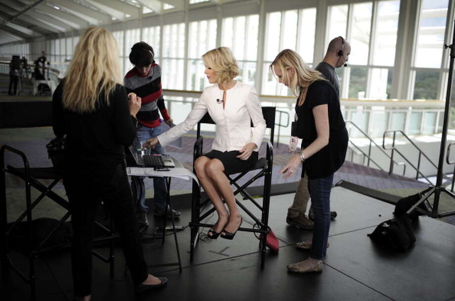 ORLANDO, FL - SEPTEMBER 22:  Fox anchor Megyn Kelly prepares for the Fox News/Google GOP Debate at the Orange County Convention Center on September 22, 2011 in Orlando, Florida. The debate features the nine Republican candidates two days before the Florida straw poll.  (Photo by Charles Ommanney/Getty Images) Photo: Charles Ommanney, Getty Images / 2011 Charles Ommanney