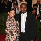 Kimye 2013: Designer darlings or fashion victims - or both? Each day seemed to bring a new bon mot or showy feud, a determinedly chic look or a high-profile wardrobe malfunction from exhaustively documented couple Kim Kardashian and Kanye West. Read more »  Pictured: A pregnant Kardashian in a less-than-flattering, form-fitting, floral-patterned maternity dress at the Met Gala.