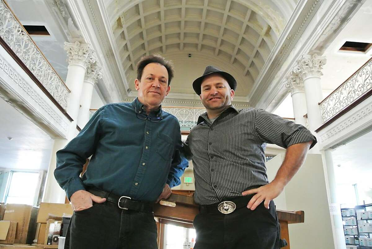 Michael Schiess, left, and Michael Sturtz inside the Carnegie Library in Alameda. They want to raise money and turn the space into the new Pacific Pinball Museum. Schiess is the founder of the museum, and Sturtz founded The Crucible industrial arts center.