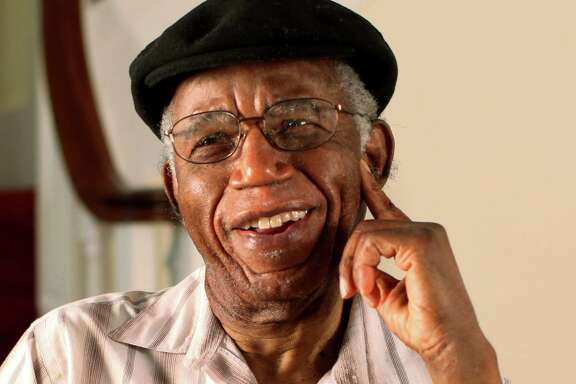 """This undated photo provided by Brown University shows Chinua Achebe at his home in Warwick, R.I. Achebe, an internationally celebrated Nigerian author, statesman and dissident, has died at age 82. Achebe's 1958 novel, """"Things Fall Apart,"""" is widely regarded as the first major work of modern African fiction and inspired others to tell the continent's story through the eyes of those who lived there. He joined Brown University in 2009 as a professor of languages and literature. (AP Photo/Brown University, Mike Cohea)"""