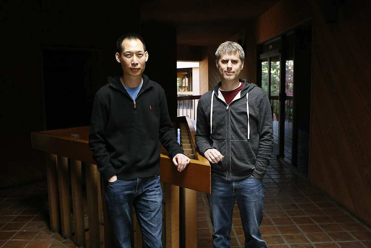 Oliver Miao, left, and Keith Emnett, co-founders of Pixelberry, a small video game studio that makes an iOS game called High School Story, pose for a portrait outside their offices in Mountain View, CA, Wednesday, December 11, 2013.