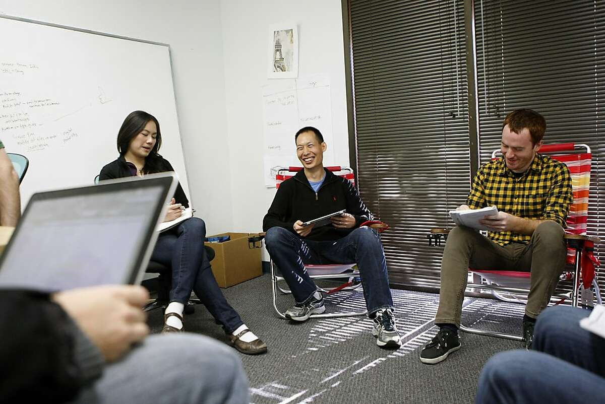 Oliver Miao, center, co-founder of Pixelberry, a small video game studio that makes an iOS game called High School Story that deals with issues such as bullying, attends a meeting with the writers at his company's offices in Mountain View, CA, Wednesday, December 11, 2013.