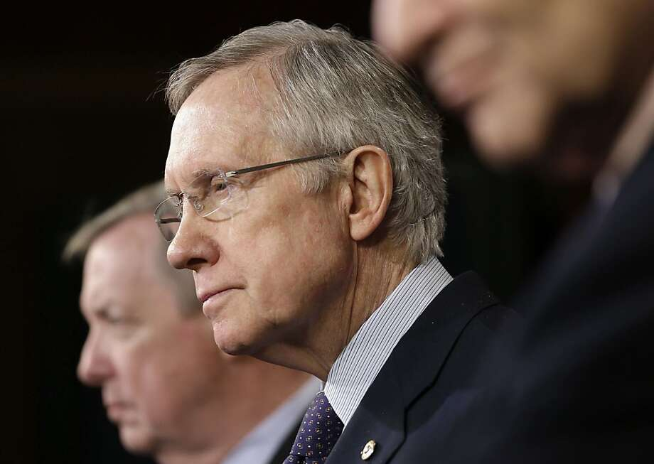 "Sen. Harry Reid, above, will push for an extension of jobless benefits but faces opposition from Sen. Rand Paul, left, who calls that a ""disservice to these workers."" Photo: Pablo Martinez Monsivais, Associated Press"