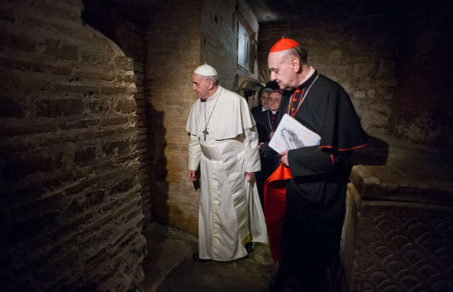 Pope Francis in April visits the necropolis, where St. Peter is believed to be buried, under St. Peter's Basilica. The pope's decision to publicly exhibit the purported relics of St. Peter has spotlighted the debate over whether the bones truly are his. Photo: Associated Press / AP
