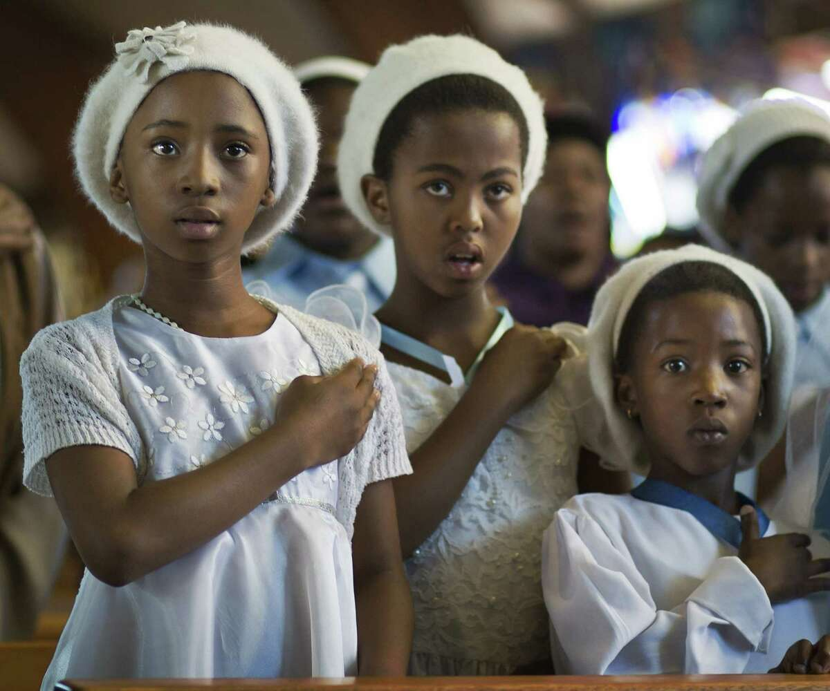 Young members of the choir attend a morning Mass in memory of Nelson Mandela at the Regina Mundi church, which became one of the focal points of the anti-apartheid struggle, in Soweto, Johannesburg, South Africa.