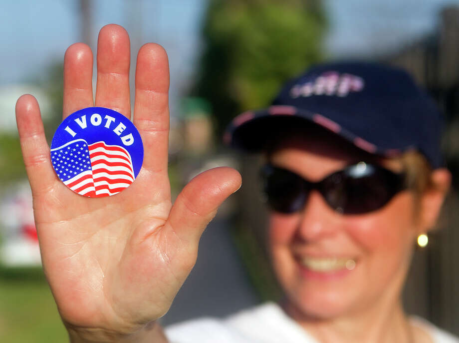 "Peggy Lindow holds up an ""I Voted"" sticker outside Crockett Elementary School Tuesday, July 31, 2012, in Houston. (Cody Duty / Houston Chronicle) Photo: Cody Duty, Staff / © 2011 Houston Chronicle"