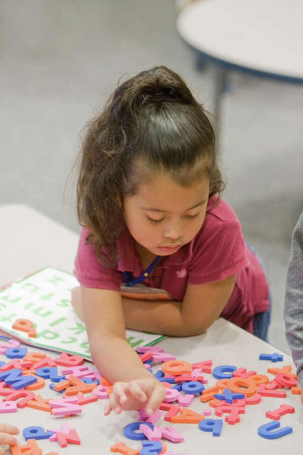 The single best boom-time investment Texas can make is in Texas children and young people. In this 2008 photo, Brianna Carrillo contemplates a pool of foam letters at Farias Early Childhood Center on East Rittenhouse.  Photo by R. Clayton McKee/For the Chronicle Photo: R. Clayton McKee, Freelance / Freelance