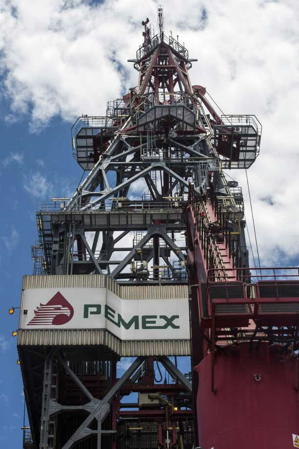 The drilling tower of an exploration oil rig features the logo for PEMEX, Mexico's state-owned oil company. In December, Mexico's Senate approved reform that breaks the country's oil monopoly by allowing foreign firms to drill for crude. Photo: OMAR TORRES, Staff / AFP ImageForum