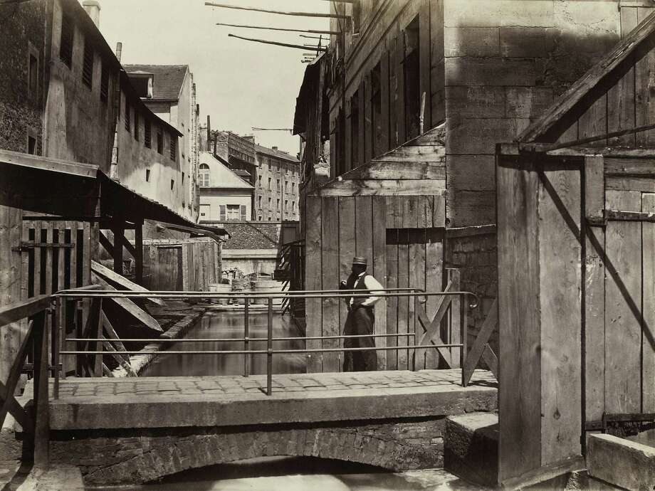 "Charles Marville's Paris photograph is from about 1862, depicting ""Banks of the Bievre River at the Bottom of the rue des Gobelins) (fifth arrondissement)."" It's now on view at the National Gallery of Art in Washington, D.C., and will next month move to New York's Metropolitan Museum of Art. Photo: Contributed Photo / Connecticut Post Contributed"