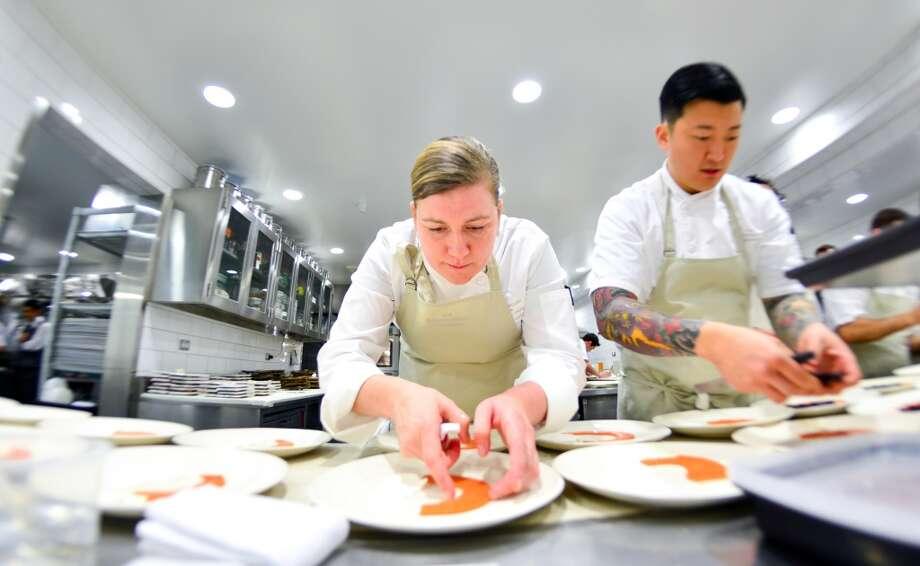 Ashley Christensen and Howard Ko plating dishes. Photo: Bonjwing Lee Photography
