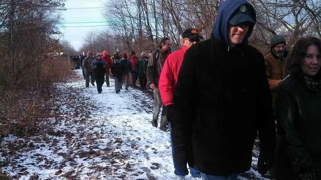 About 50 people gathered on Saturday, Dec. 7, to cut the ribbon and walk on the newest part of the Helderberg-Hudson Rail Trail, which stretches three miles from the intersection of Grove Street and Voorheesville Avenue in Voorheesville and Upper Font Grove Road in Slingerlands. It joins 1.9 completed miles in the town of Bethlehem, marking the halfway point of completion for the trail which will stretch from the Port of Albany to the village of Voorheesville. For information, visit mohawkhudson. (Submitted by Kathy