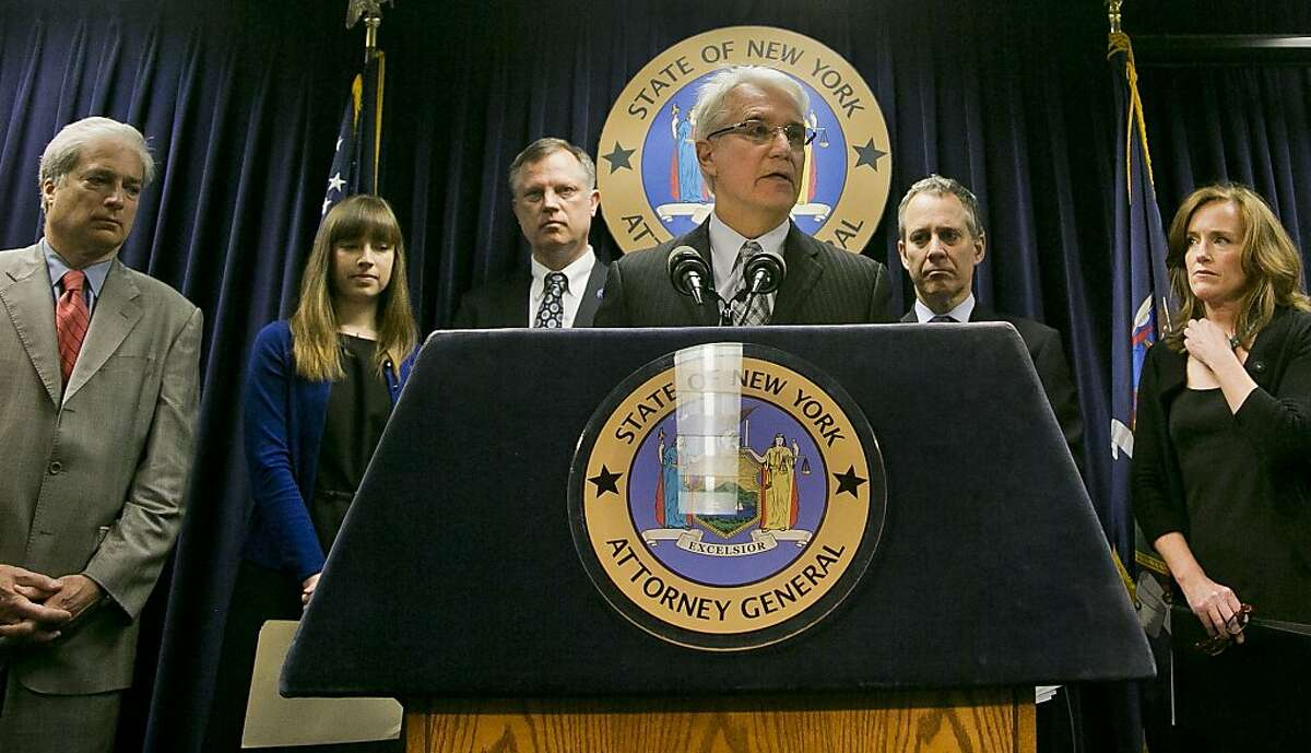 File - In this June 13, 2013 file photo, Citizens Crime Commission of New York president Richard Aborn, far left, Annie Palazzolo, second from left, and her father Paul Boke, third from left, New York Attorney General Eric Schneiderman, second from right and Nassau County, N.Y. Distrct Attorney Kathleen Rice, far right, listens as San Francisco District Attorney George Gascon speaks about using technology to avert smartphone theft during a press conference on Thursday, June 13, 2013, in New York. Palazzolo, 29, also spoke about her sister who was killed for her cellphone. San Francisco's top prosecutor said Monday Samsung Electronics, the world's largest mobile phone manufacturer, has proposed making a