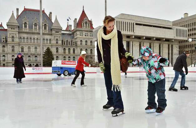 Meghan Ruiz of Troy and her 6-year-old son Luka Ruiz take to the ice Rink Friday Dec. 13, 2013, during this year?s opening of the Empire State Plaza Ice Rink in Albany, NY.  The New York State Office of General Services (OGS) officially opened the rink for the season. The opening was previously delayed due to a stretch of unseasonably warm weather. (John Carl D'Annibale / Times Union) Photo: John Carl D'Annibale / 00025022A