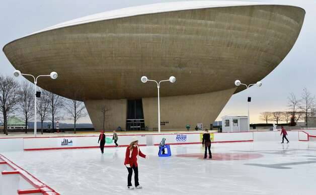 Skaters take to the ice against the backdrop of the State Capitol during this year?s opening of the Empire State Plaza Ice Rink Friday, Dec. 13, 2013, in Albany, NY.  The New York State Office of General Services (OGS) officially opened the rink for the season. The opening was previously delayed due to a stretch of unseasonably warm weather. (John Carl D'Annibale / Times Union) Photo: John Carl D'Annibale / 00025022A
