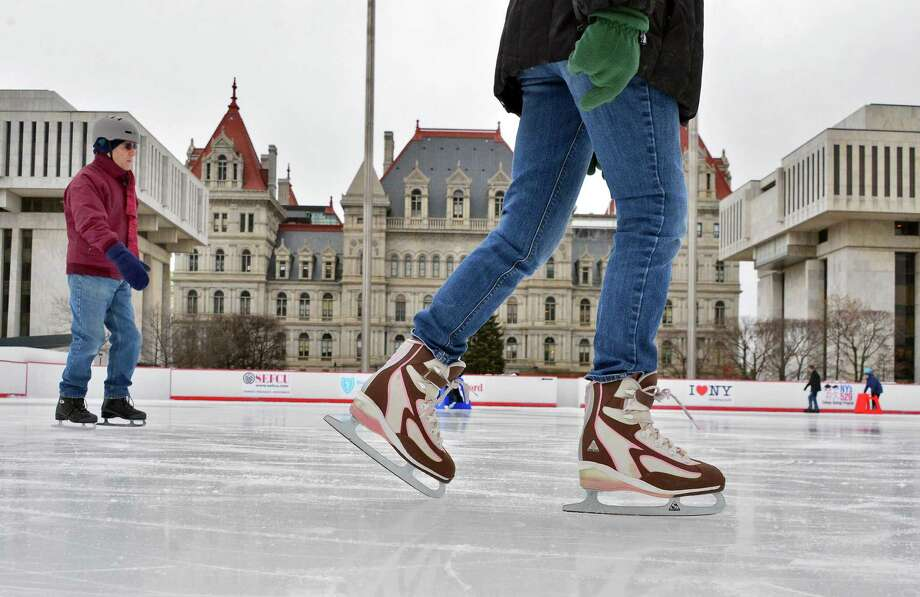 Skaters take to the ice against the backdrop of the State Capitol during this year?s opening of the Empire State Plaza Ice Rink Friday, Dec. 13, 2013, in Albany, NY.  (John Carl D'Annibale / Times Union archive) Photo: John Carl D'Annibale / 00025022A