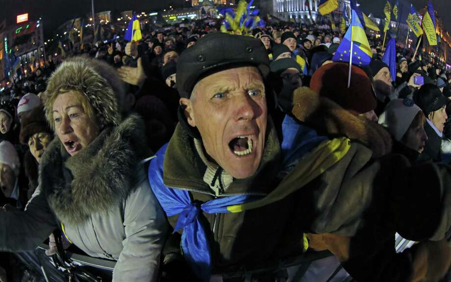 Pro-European Union activists become animated listening to Ukranian opposition leader Oleh Tyahnybok during a rally in Independence Square in Kiev, the country's capital. Photo: Dmitry Lovetsky / Associated Press / AP