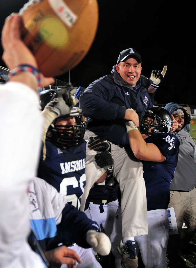 Ansonia's Head Coach Thomas Brockett is hoisted into the air as the team wins the Class S football championship against Woodland 51-12 at Central Connecticut State University's Arute Field in New Britain, Conn. on Friday December 13, 2013. Photo: Christian Abraham / Connecticut Post